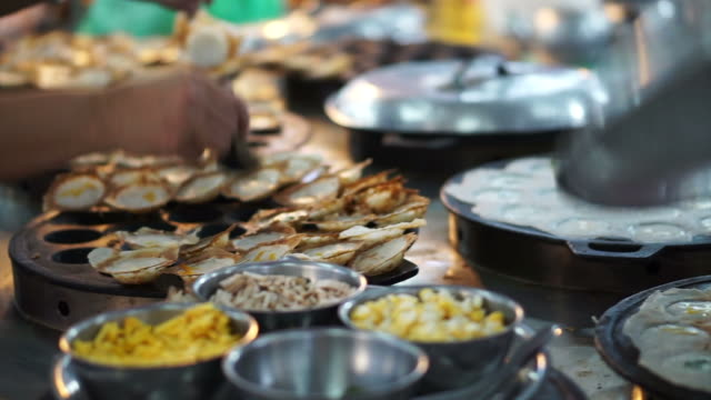 Kanom Krok, Thai local dessert, coconut milk and flour. Common food for breakfast, selling in every market video