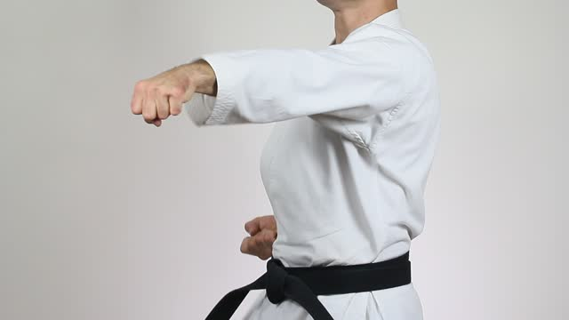 Karateka trains punches
