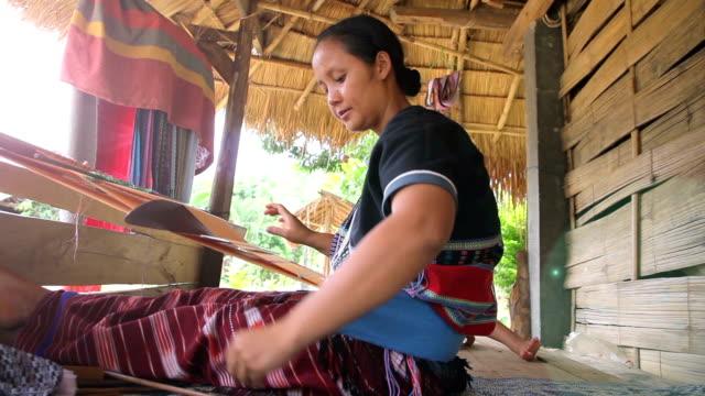 Karen women talking on the mobile phone while weaving video