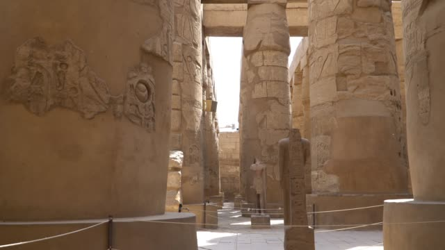 karnak temple in luxor, egypt. the karnak temple complex, commonly known as karnak, comprises a vast mix of decayed temples, chapels, pylons, and other buildings in egypt. - бог стоковые видео и кадры b-roll
