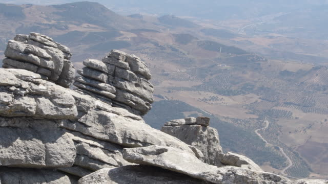 Karst rocks with valley at background in the Antequera Torcal, Spain