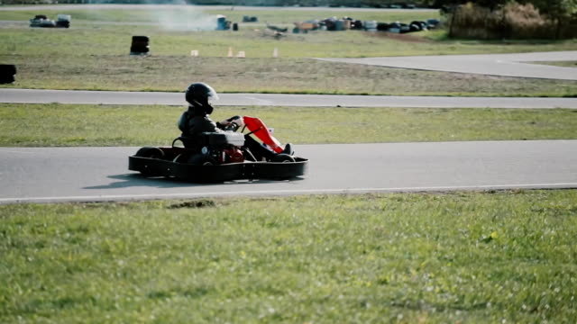 Kart drivers moving on a go kart track Two kart drivers moving on a go kart track. go cart stock videos & royalty-free footage