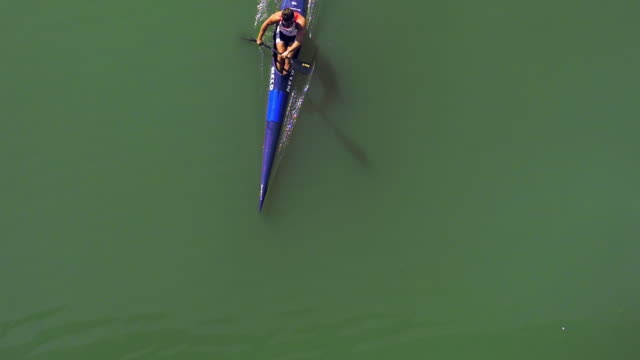 Kayak crossing from above the guafalquivir river in sevilla slowmotion video