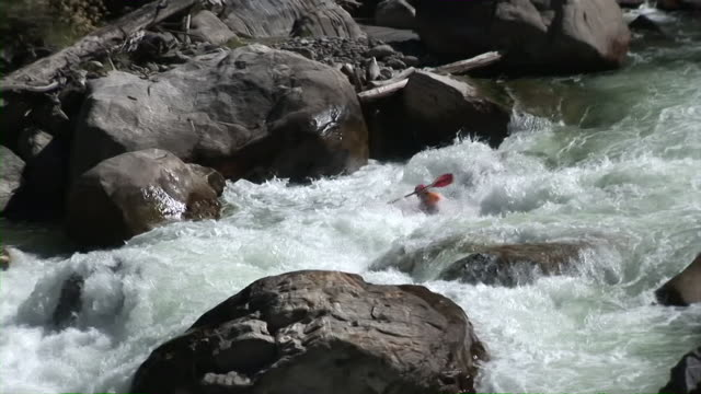 Kayaker descends extreme whitewater rapid video