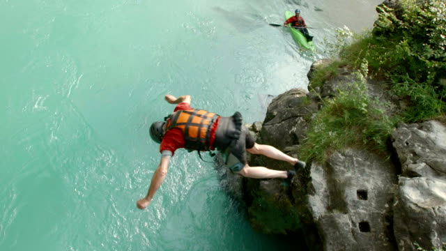 HD: Kayaker Doing A Front Flip Into The River video