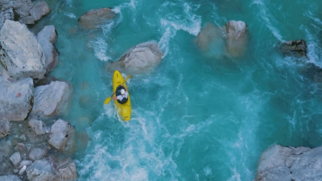 Kayaker Paddling on a Dangerous River A guy kayaking through rapids recreational boat stock videos & royalty-free footage
