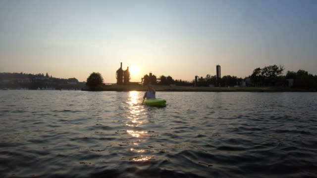 Kayaker Sunset Silhouette Shot Paddling Towards Camera - Gas Works Lake Union - Seattle, WA video