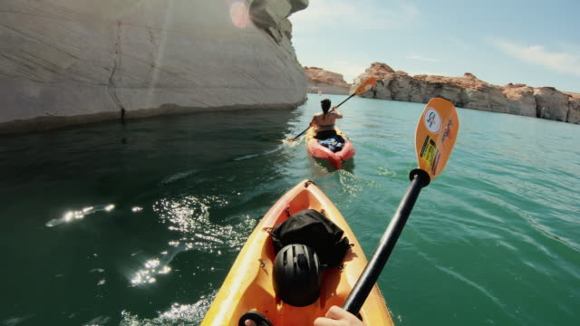 pov kayaking in canyons of powell lake recreational area - prospettiva del fotografo video stock e b–roll