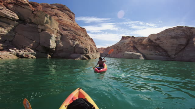 pov kayaking in canyons of powell lake recreational area - canada travel stock videos and b-roll footage
