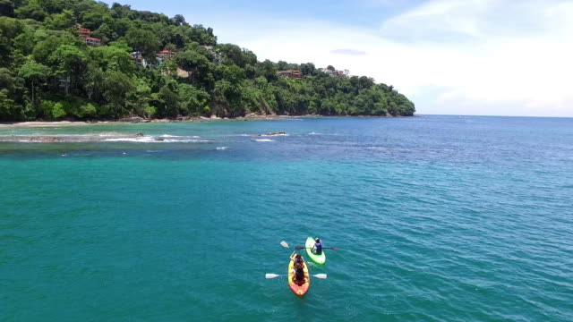 Kayaking in tropical waters aerial drone view. Young man practicing water sports. Water sports in the Caribbean. caribbean stock videos & royalty-free footage
