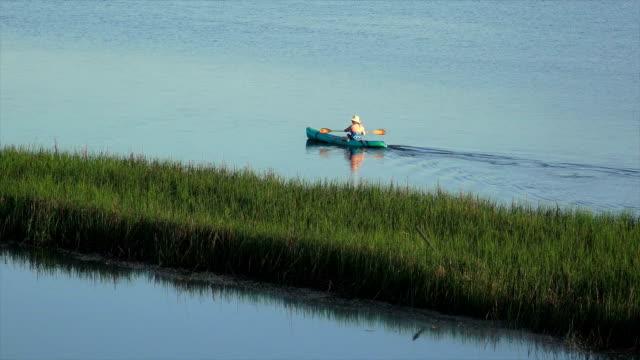 Kayaking on the marsh (from 4K) video