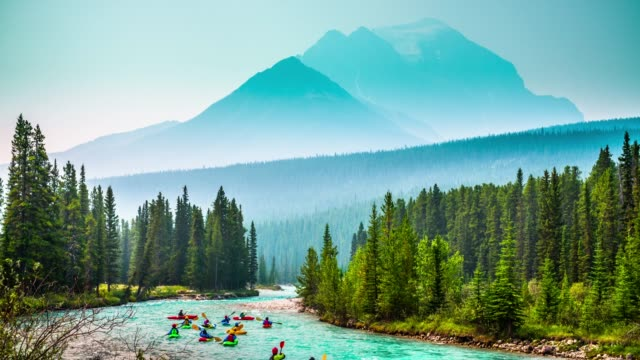 Kayaks on Bow River in Banff National Park - Alberta, Canada