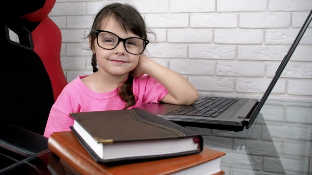 keep on working. keep on working. The girl with glasses at the desk continues to work after the break. pigtails stock videos & royalty-free footage