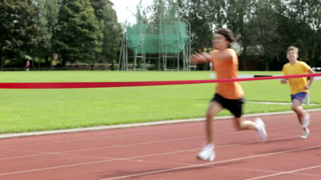 keep-fit-kids - track and field stock videos and b-roll footage