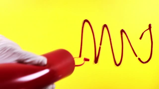 ketchup splashes isolated on yellow  background - ketchup video stock e b–roll