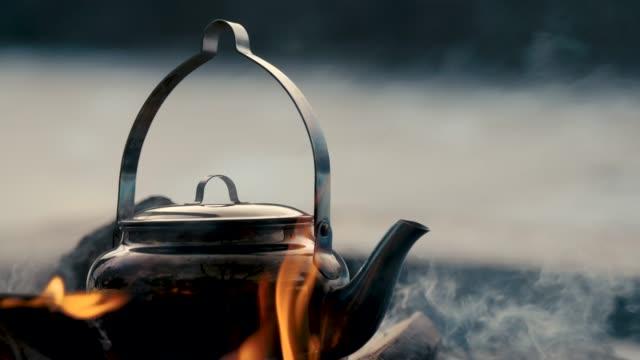 A kettle on a bonfire