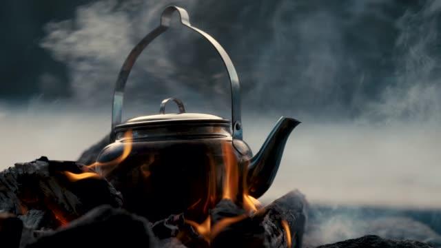 a kettle on a bonfire - ice on fire video stock e b–roll