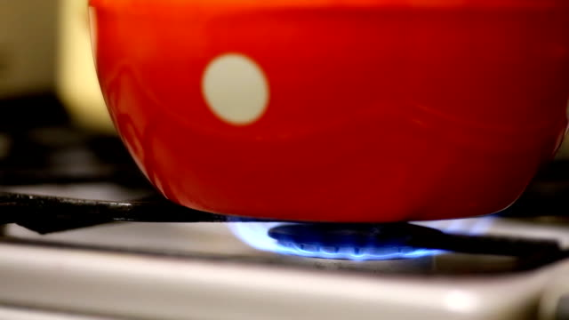 kettle on a gas stove fire - teapot stock videos & royalty-free footage
