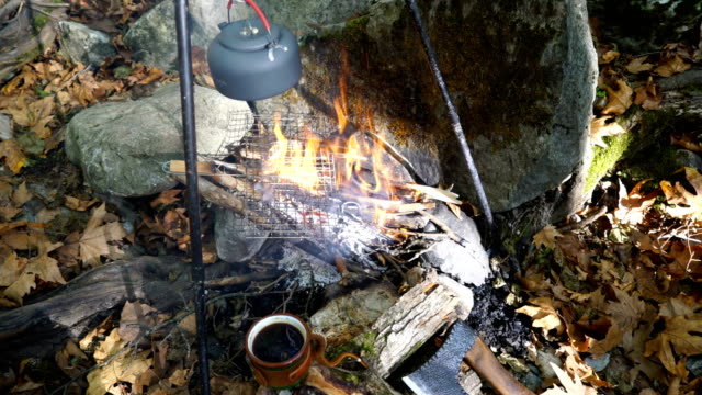Kettle on campfire at the forest