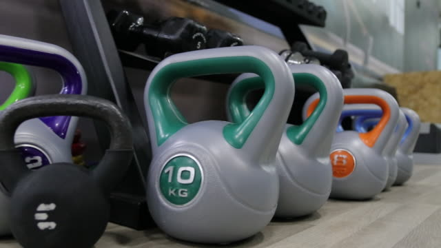 Kettlebell and hand weights at gym