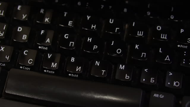 keyboard for a computer with english, russian and ukrainian layout. - lingua russa video stock e b–roll