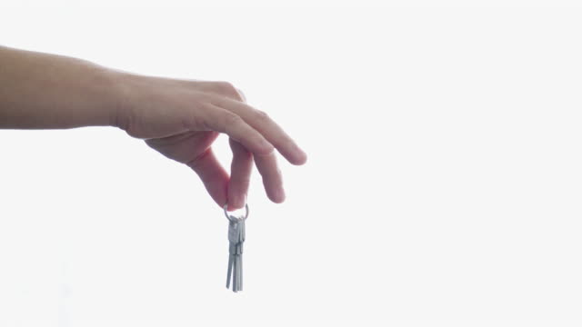 Keys to the new house in hand.