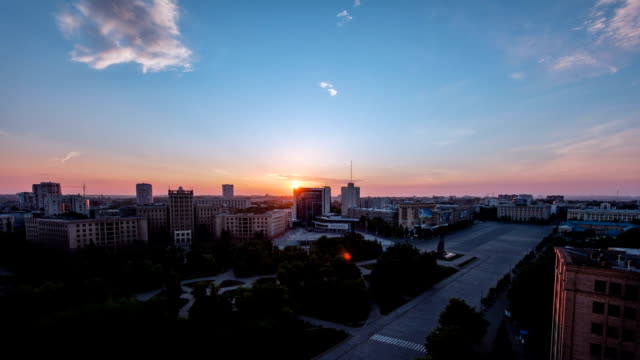 Kharkiv city from above at sunrise timelapse. Ukraine Kharkiv city from above at sunrise timelapse. Aerial view of the city center and freedom square. Ukraine. sunrise dawn stock videos & royalty-free footage