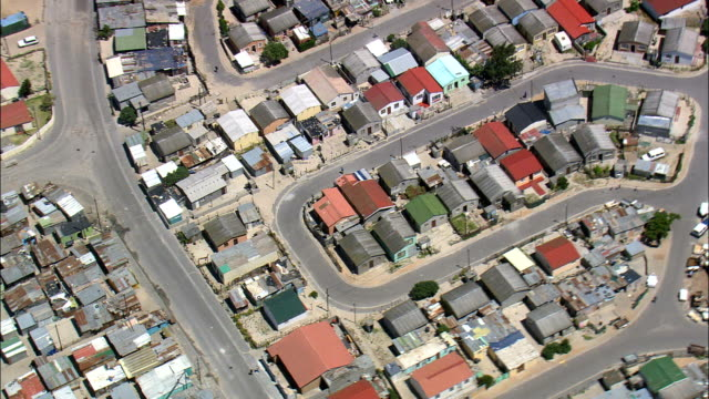 Khayelitsha  - Aerial View - Western Cape,  City of Cape Town,  South Africa This clip was filmed by Skyworks on HDCAM SR 4:4:4 using the Cineflex gimbal. Western Cape,  City of Cape Town,  City of Cape Town South Africa western cape province stock videos & royalty-free footage
