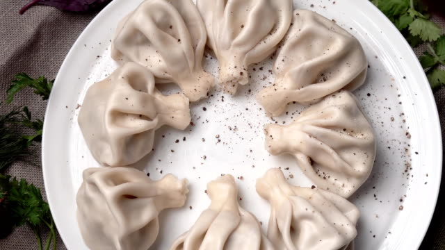 khinkali with pepper is spinning on a plate video