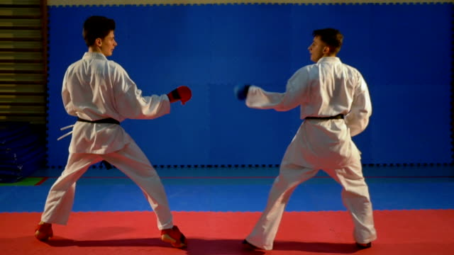 Kick box competition practice at the dojo in slow motion video