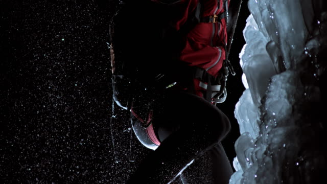slo mo kicking the ice slope with crampons - eisklettern stock-videos und b-roll-filmmaterial