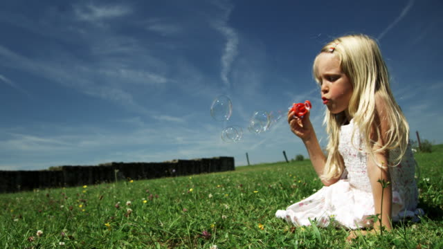 Kid blows bubbles (Shot on Red) Selected Takes - Shot on RED ONE less than 10 seconds stock videos & royalty-free footage