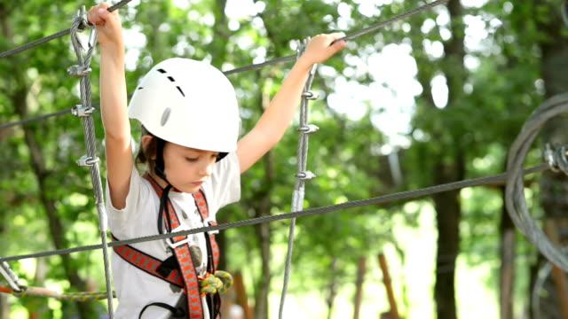 Kid Climbing in Adventure Park video