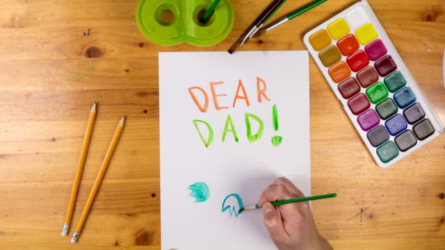 Kid draw greeting card for fathers day, stop motion animation video