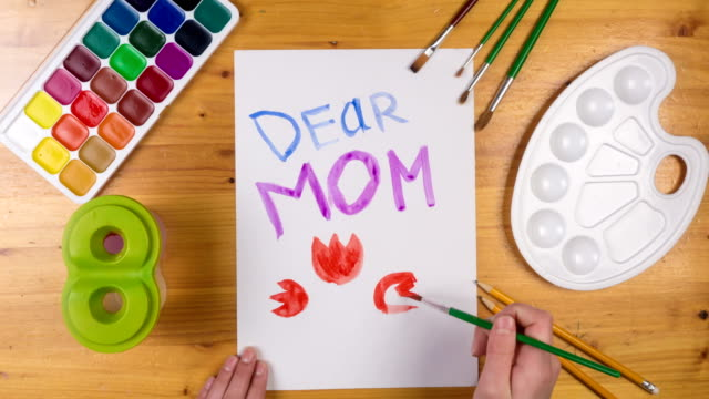 Kid draw greeting card for mothers day, stop motion animation Kid draw greeting card on white paper for mothers day, stop motion animation, top view mothers day stock videos & royalty-free footage