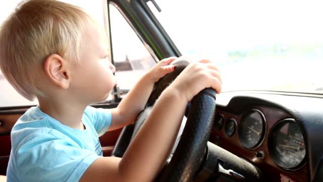 kid driving a car video