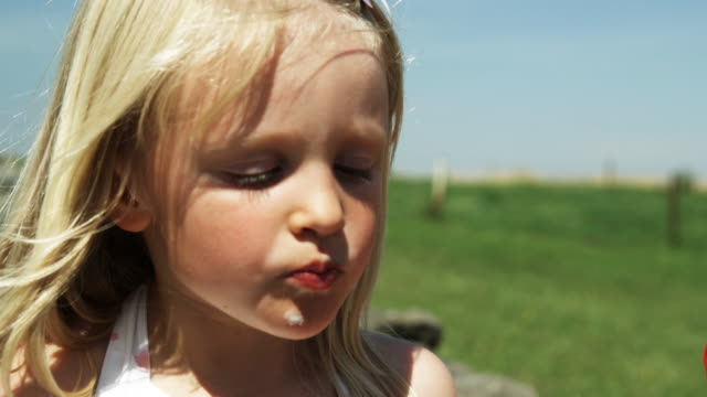 Kid eating Ice Cream (SHot on Red) video