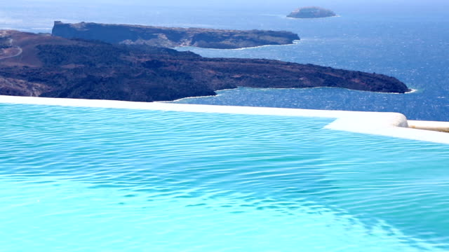 HD: Kid in infinity swimming pool on Santorini video