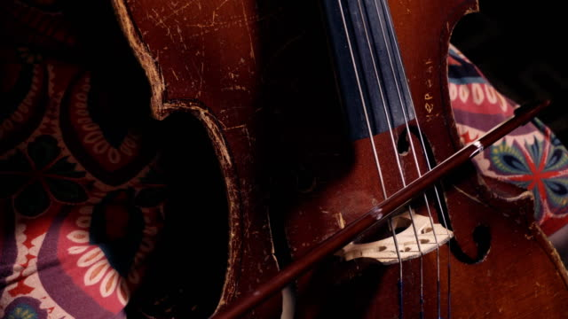 kid playing of old shabby cello video