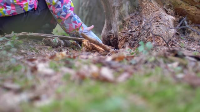 Kid Playing Treasure Hunt Game Hiding and Finding Geocache Container in Forest