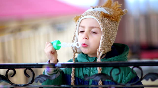 Kid Playing with Bubble Blower video