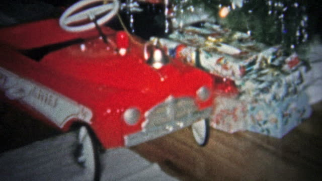 NEW HAVEN, CONN. USA - 1957: Kid playing with red fire truck Christmas gift. video