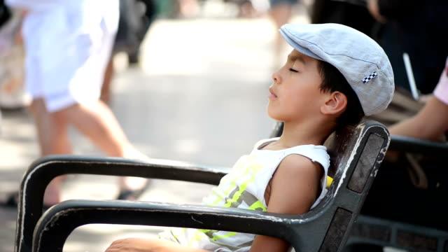 Kid Sleeping on Bench video