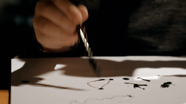 Kid trying to draw with ink pen video
