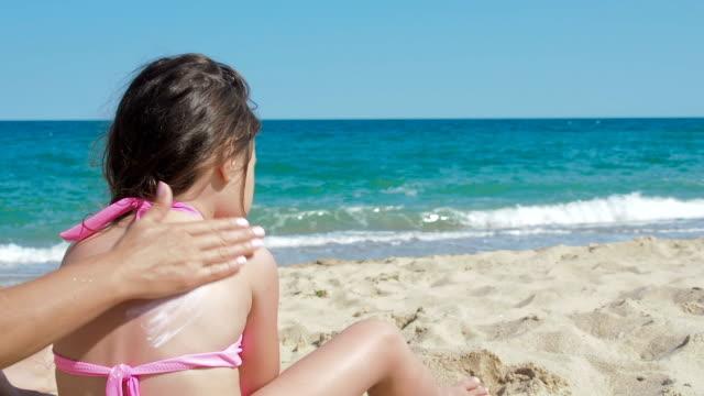 kid using sun protection. - sun cream stock videos & royalty-free footage