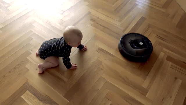 Video Kid versus Robot Vacuum Cleaner