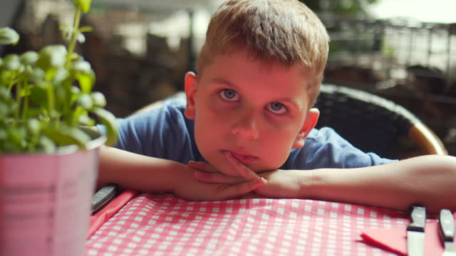 Kid waiting for meal Kid waiting for meal impatient stock videos & royalty-free footage