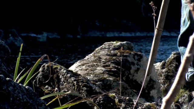 kid walking on the rocks video