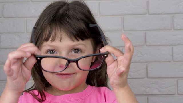 Kid with bad eyesight.