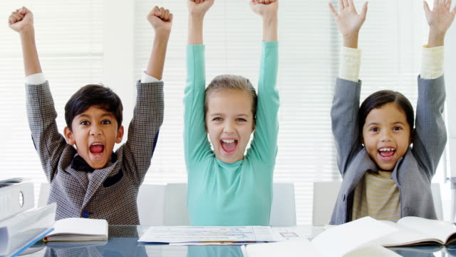 Kids as business executive smiling with their arms up 4k video